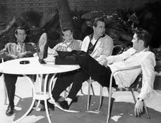 Elvis with some of the guys at his California home.