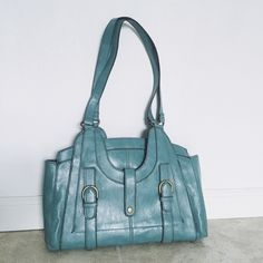 """Urban Outfitters blue vegan leather purse hand bag Cute bag in excellent condition. Has 3 compartments and a zipper pocket inside. Measures 14"""" wide and 11"""" tall not including shoulder straps. Inside is very clean. Coming from a smoke-free and pet-free home. Urban Outfitters Bags Shoulder Bags"""
