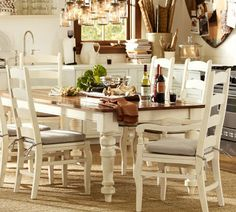 Love this DIY dining table makeover! The gorgeous dark wood top pairs so well with the crisp white legs!