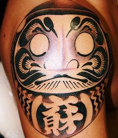 Black Ink Daruma Doll Tattoo Design For Shoulder
