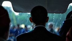 Photo: As rain falls, President Barack Obama begins to take part in the annual Memorial Day ceremony at Abraham Lincoln National Cemetery, Elwood, Ill., May 31, 2010. (Official White House Photo by Pete Souza)