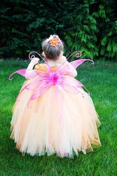 Can you imagine how beautiful she would be if I could paint a mask on her in bright pinks and oranges!!  And it is an Easy to make fairy costume tutu dress....