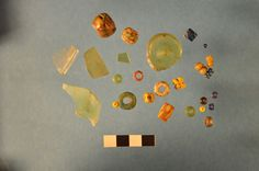 "Article about find of royal Viking city of Silasthorp, c 700-1000 CE ""Using geophysical tools, the archaeologists discovered pots and rocks hidden in the soil. But the tools were unable to detect the many beautiful glass beads, so they were a pleasant surprise to the archaeologists when they started digging. (Photo: University of Aarhus)"""