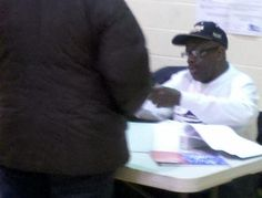 This photo was taken by a voter this morning on Election Day, in President Obama's home ward, Ward 4 Precinct 37 at 1212 S. Plymouth Court in Chicago. The image shows an election judge wearing an Obama hat while passing out ballots to voters inside the poling place.