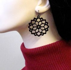These beautiful laser-cut flower earrings are made from black acrylic,they hang on NICKEL FREE Gunmetal plated over brass earwires and measure 2.2 inches tall by 1.7 inches wide.(56X43 mm).     These earrings make a bold statement, yet are surprisingly lightweight and easy to wear.     All of my jewelry comes with a gift box.  Price: $27