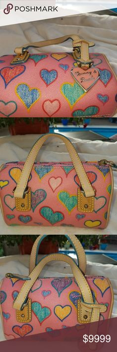 Dooney & Bourke 💘Pink💘 Mini Bag Dooney & Bourke Pink Multi-colored 💘Hearts Mini Bag. So cute! 🤹Fun🤹 shades of ❤Red, 💚Green, 💛Yellow, 💙Blue, 💟Light Pink. completed with the multi-colored zipper, 🐮All Leather, 💖pink heart hang tag. Very good condition for bag age, lining very good. Great price, overall. Dooney & Bourke Bags Mini Bags