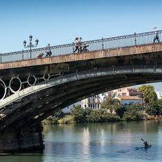 In #Seville the oldest #Triana or Isabel II #bridge rebuilt by...