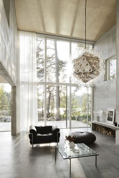 In the forest, a concrete and glass home. Casa Vogue, Photo: Mikael Olsson