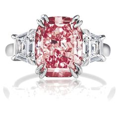 This is my all time fantasy-type ring! A vivid pink diamond set with white diamonds and platinum. Yessss, PLEASE!