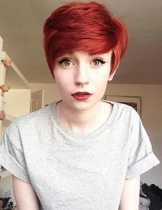 Short Red Hair--I like the combination of her hair with the lips and eyes