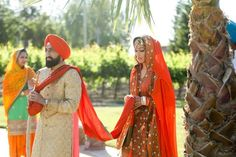 Sikh bride and groom walking to the gurdwara Sikh Bride, Sikh Wedding, Budget Wedding, Wedding Ideas, Lehenga Suit, Pastel Roses, Central California, Reception Decorations, Groomsmen