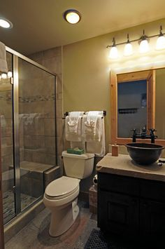 Guest bath - decorative towels above toilet - add shelf above towels, put hooks on other wall for usable towels