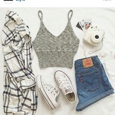 Flannel with a grey crop top, high waisted shorts and white converse