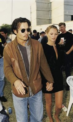 Old-school Kate Moss and Johnny at a music festival.