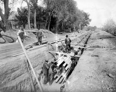 Crews lay a 48-inch wood-stave pipe in County Road 1, Denver, in this 1910 photo.