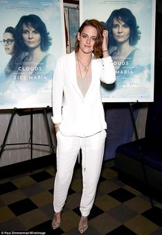 Cracking a rare smile: Kristen Stewart suited up for a Manhattan screening of her film Clo...