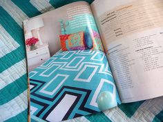 It's the Ethan Allan Quincy bed I love, in the turquoise I  love. See, it can be modern! (quilt is Modern Blocks by Amy Garro of 13spools.com)