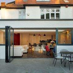 The kitchen on this Victorian terrace house has been extended to the side and the rear, creating a large kitchen/dining space and a small sitting area at the rear. Kitchen Diner Extension, Open Plan Kitchen, Pergola Canopy, Pergola Shade, Pergola Plans, Pergola Kits, Pergola Ideas, House Extension Design, House Design
