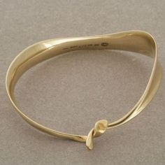 "Vivianna Torun gold ""ribbon"" bangle no. 927"