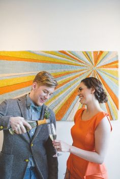 Scandinavian minimal brunch wedding with yellow, orange, and blue and a bottle of champagne // Emily Elizabeth Events + A love supreme photography + Pretty Flowers Maine + Solo Bistro + Joseph's + Miss