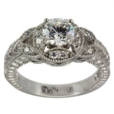 Vintage Diamond Accented Milgrain Filigree Engagement Mounting -  This diamond engagement setting will hold between a 0.55ct and 0.65ct center diamond.      The ring has brilliant round diamonds to further enhance the center diamond.         The engraving,milgrain and the openworkof the gallery give this ring theunmistakable appearance of vintage diamond rings.           Our rings have thick and durable shanks which will give many years of trouble-free wear. Dacarli has been...