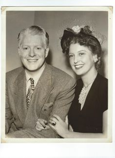 Radio Days - vintage photo of Jeanette MacDonald and Nelson Eddy when she made an appearance as a guest on his radio show. Notice the huge emerald and diamond engagement ring Nelson gave her when they were filming Rose Marie. Such happy smiles!