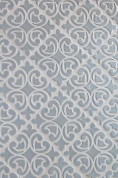 This Hiser decorative tile in Light Gray glaze was inspired by wallpaper found in the company owner's 1893 family home | juleptile.com
