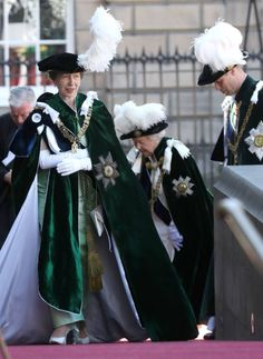 (C) Queen Elizabeth II donned her full regalia to attend the Thistle Service in Edinburgh was accompanied by her grandson Prince William and her only daughter Princess Anne (L) who also wore ceremonial robes and feathered hats as they attended the service.