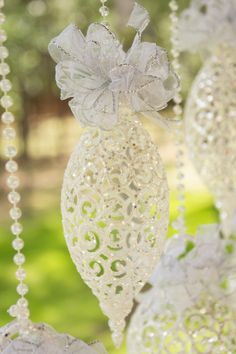 silver and crystal ornaments add sparkle to wedding décor - thereddirtbride.com - see more of this wedding here