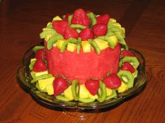 I made this fruit cake for my husbands birthday dinner, as he is not fond of cake.  This cake is made entirely of fresh fruit, which is cleverly arranged in the shape of a cake (basically a carefully arranged fruit salad).  It was a big hit with my hubby and the rest of our family, especially the kids.  Its healthy, people can pluck off whatever fruit they desire and cut whatever size slice of watermelon they like, and the types of fruit used are interchangeable.  Creative substitutions are…