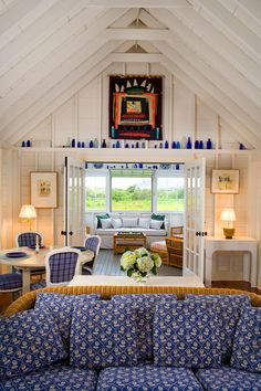 Do you feel the ocean breeze coming in? White and bright blues pair together nicely along with abundant windows and doors to get a beachy vibe. #coastal #cottage #cabin #decor