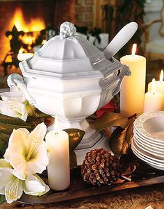 Elegant Tureen (Country Living)  Sitting pretty amid candle pillars, amaryllis blossoms, and magnolia leaves: a soup tureen found at a flea market.