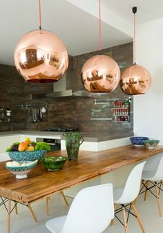 Love the tom dixon pendants...