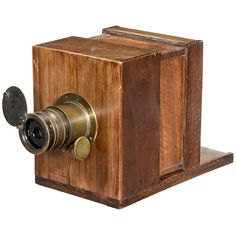 """Sliding-Box Camera by Charles Chevalier, c. 1849 Camera and lens marked: """"Photographe à verres combines inventé par Charles-Chevalier, Ingenieur, Palais Royal 158, Paris"""". With convertible lens (4 elements), diaphragm marked: """"Paysages ET Gravures"""", flip shutter (marked: 19/23), length of the lens 6 in., rack-and-pinion focusing (stuck). Plate size of the camera 5 ½ x 6 ¾ in., baseplate 13 1/3 x 7 4/5 in., focusing screen back."""