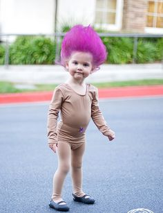 Emma has been playing with my old trolls...and wants to be one for Halloween! I think it would be cute to add a tutu and tummy jewel. For grace too!