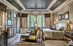 The master suite bed room has a beautifully detailed ceiling and generous windows.