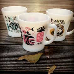 Fire King white glass mugs made in Japan. Art by Mooki.
