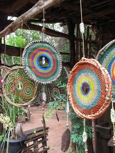 I don't believe in dream catchers, or like them, but I think the woven circles alone would make beautiful indoor/outdoor wall art or hanging as in this pic. Dream Catchers, Diy And Crafts, Arts And Crafts, Deco Nature, Ideias Diy, Suncatchers, Handicraft, Wind Chimes, Fiber Art