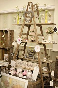 """Vintage Ideas This ladder display is the perfect visual to show how to """"pyramid"""" in your store. More - Today we're throwing it back with some adorable vintage wedding ideas. We're loving everything about this rustic wedding inspiration today. Ladder Display, Ladder Decor, Wooden Ladder, Ladder Shelves, Window Shelves, Design Shop, Store Design, Decoration Vitrine, Wedding Fair"""