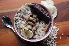 Nutty banana porridge. Over the hob cook up 27g Quaker oats with 15g desiccted cocobut, 15g golden linseed, almond milk and splash of water. Top with sliced banana, mixed nuts, grated dark chocolate and chocolate sauce. and chocolate coated brandy snap if you want to be really fancy. #fancypantsporridge #porridge #porridgepasion #showusyouroats