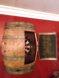 Wine & Darts Cricket, Lets play some darts with WineyGuy original. Made from repurposed Napa Valley Wine Barrel. We took this wine barrel and split it long ways, put back on it, cut…More 4 9 8 9 5 Man Cave Garage, Garage Bar, Garage Ideas, Car Garage, Barris, Dart Board Cabinet, Barrel Projects, Wood Projects, Wine Barrel Furniture
