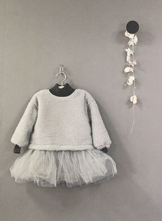 The Only Girl in the House Blog gives great interiors inspiration for grey nursery, gray nursery, baby room, baby bedroom, kids bedroom. pretty grey girls room dress