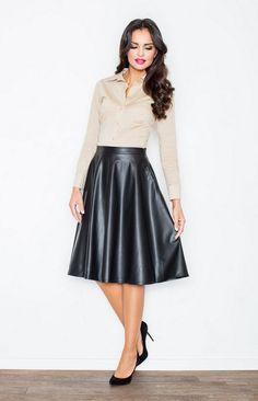Jupe simili cuir évasée noire, Jupe évasée simili cuir.Allure chic  garantieavec cette jolie a0d35e38886