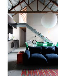 Heidi Dokulil and Richard Peters' Sydney loft, blue couch, exposed beams, interior design, moody home.