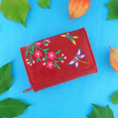 From Elma collection designed by PETA approved vegan brand LAVISHY, this small/tri-fold wallet features delightful dragonfly and flower embroidery motif. Made with Eco-friendly vegan materials that are toxic-free, recyclable and biodegradable (tested by SGS), it's original, beautiful and fun for everyday use, also makes a great gift for your family and friends. Wholesale available at www.lavishy.com to gift shops, fashion accessories and clothing boutiques in Canada, USA and around the… Embroidery Motifs, Flower Embroidery, Clothing Boutiques, Boutique Clothing, Gift Shops, Moroccan Pattern, Tri Fold, Small Wallet, Peta