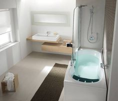 Walk in bathtubs are not accessible for everyone but can work great for people with disabilities. Modern bathtubs from Teuco, www.teuco.com/ are very functional, stylish and space saving. The elegant door is created by a tall clear glass enclosure screen panel that allows you to see the water level in the tub. The bathtub and shower combo create nice and modern bathroom design with the tall shower door which blocks splashing and eliminates the need for a shower curtain.