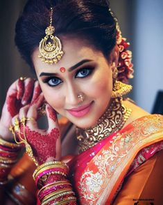 South Indian bride.Gold Indian bridal jewelry.Temple jewelry. Jhumkis.Red silk kanchipuram sari.Braid with fresh jasmine flowers. Tamil bride. Telugu bride. Kannada bride. Hindu bride. Malayalee bride.Kerala bride.South Indian wedding.