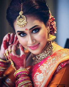South Indian bride.Gold Indian bridal jewelry.Temple jewelry. Jhumkis.Red silk kanchipuram sari.Braid with fresh jasmine flowers. Tamil bride. Telugu bride. Kannada bride. Hindu bride. Malayalee bride.Kerala bride.South Indian wedding.