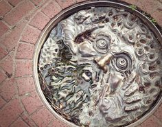 Manhole cover. -correction! Fountain in front of The Boulder Bookstore