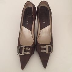 Christian Dior Pumps Chic dark brown matte leather pumps. Authentic Dior. True to size 36. Used, signs of wear on toe, soles, heels. The D hardware is tarnished but could probably be shined. Final sale. Please ask all questions before purchasing. I'm happy to send more photos. Christian Dior Shoes Heels